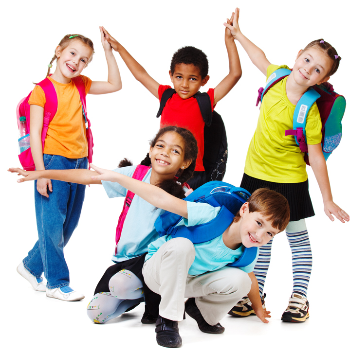 Happy children with backpacks on, gathered together and posing for a photo.