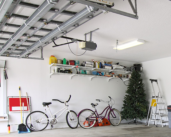 A well-organized garage, naturally lit by the light coming in through the garage door
